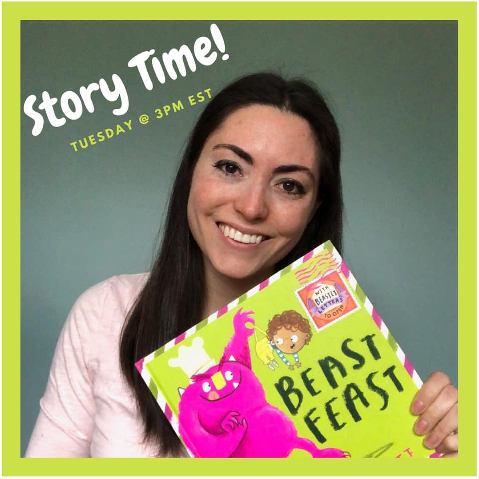 a woman with dark hair holding a children's book wearing a pink shirt
