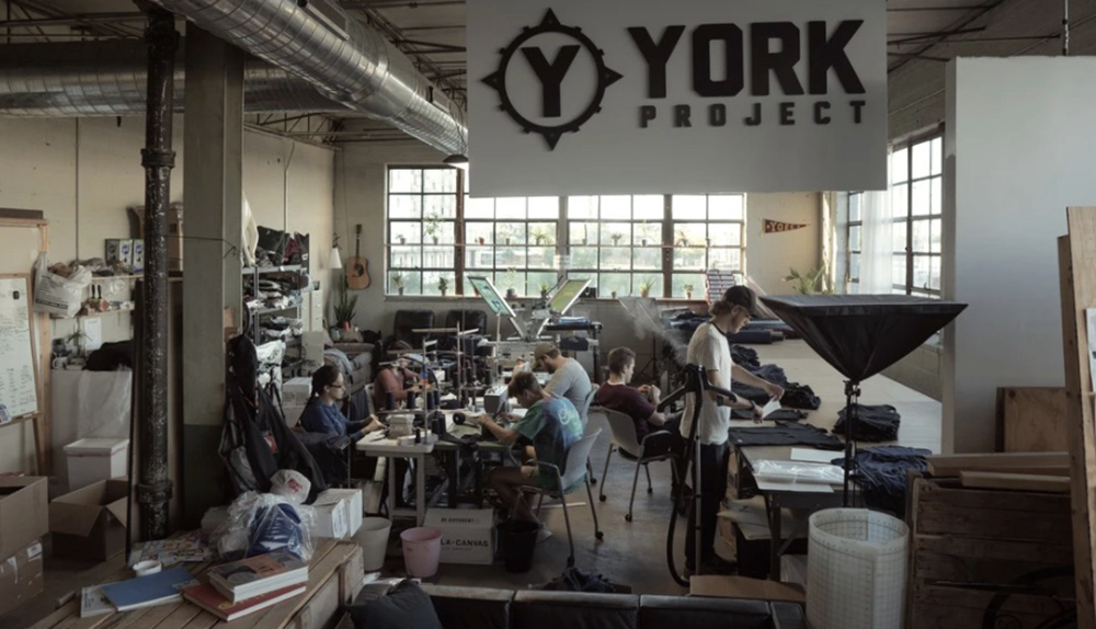 a group of people working in a warehouse